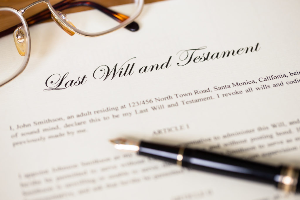 Last will and testament with pen and glasses concept for legal d